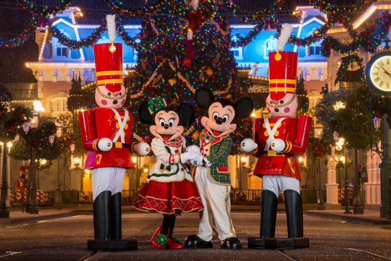 Mickey's Christmas Party meet and greet with Mickey and Minnie in front of the Christmas tree.