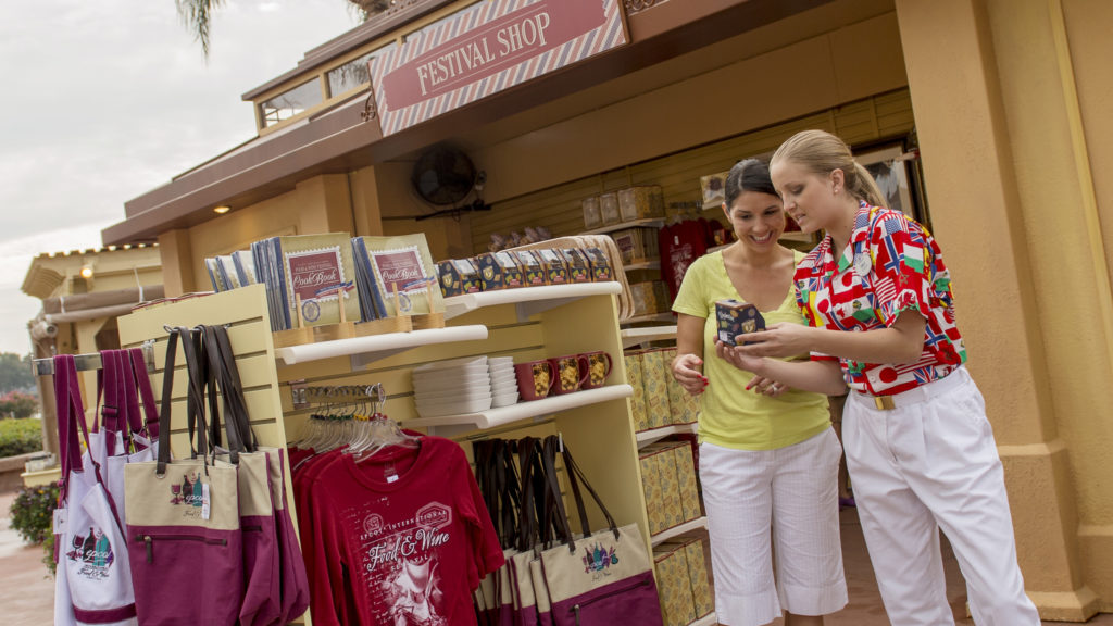 Girls souvenir shopping at Epcot Food and Wine Festival