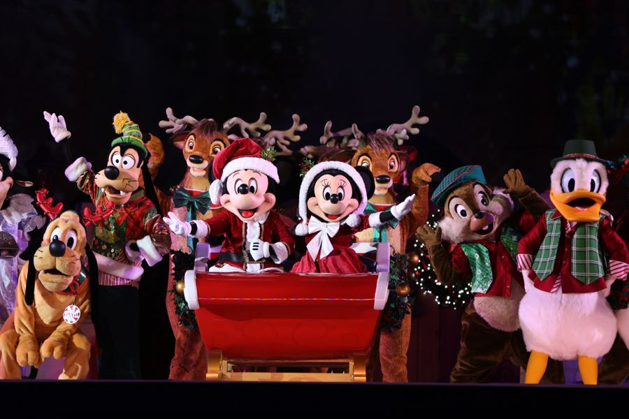 Mickey and his friends' celebrating at the Christmas Party in front of the Castle.