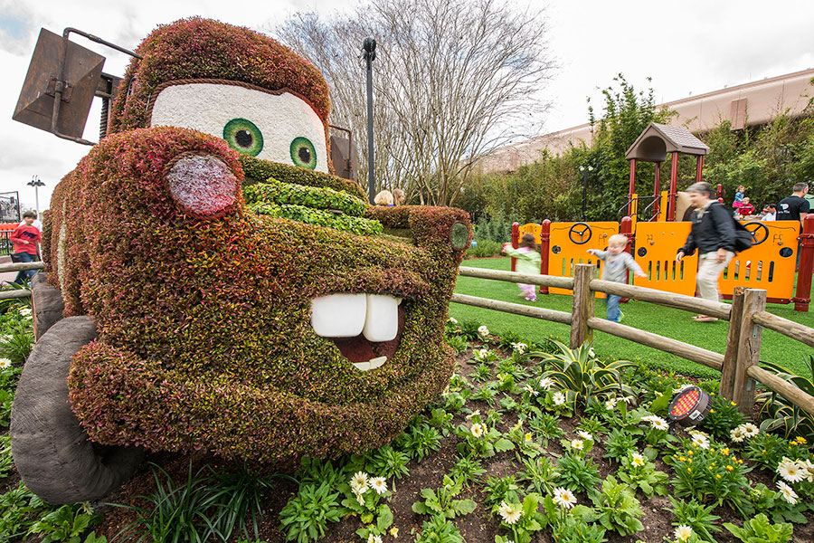 """Imagination Pavilion Gardens featuring a trimmed hedge of Mater from """"Cars"""" the movie"""