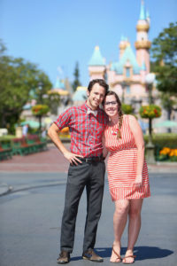 Disneyland Dapper Day: a couple posing in front of the castle dressed in 50s clothing