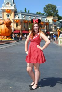Disneyland Dapper Day: Girl posing in Mickey Ears and a polka dot dress with some flats.