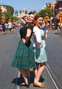 Disneyland Dapper Day: ladies in 50s wear posing on beautiful Main Street