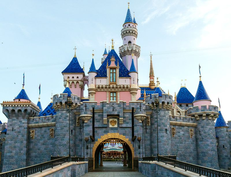 Sleeping Beauty's Castle new paint job with darker blue roofs and pixie dust sparkles