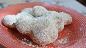 Powdered sugar mickey beignet