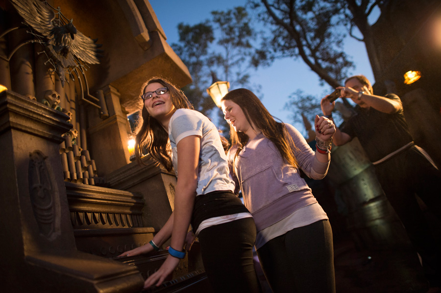 teenagers at disneyland laughing
