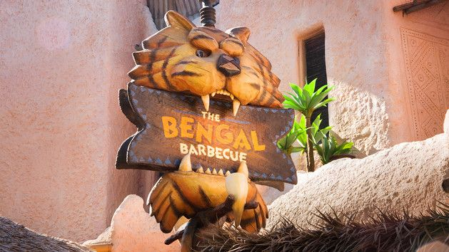 Bengal Barbecue sign with a tiger holding the sign in his mouth.