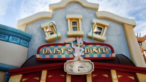 Picture of Daisy Duck holding a pizza with the sign for Daisy's Diner