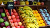 Picture of apples, bananas, and oranges at the fruit cart