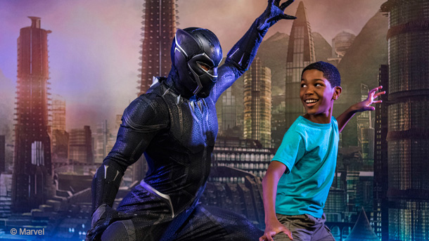 Black Panther posing with child