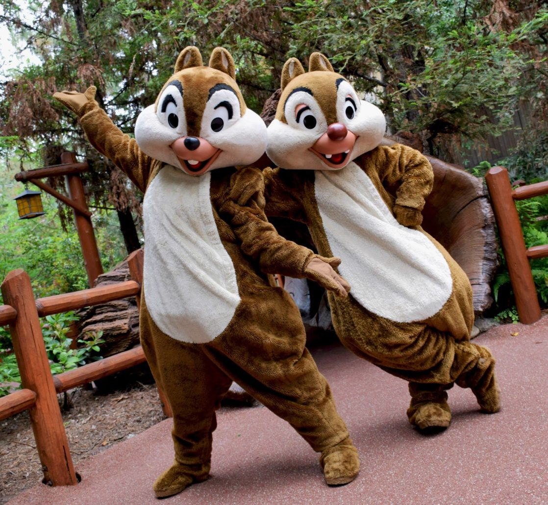 Chip and Dale pose in front of a tree