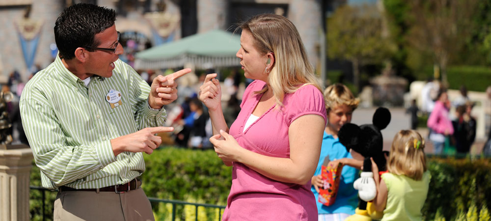 Cast member signing to another guest
