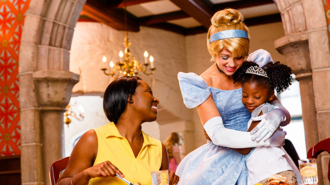 Little girl hugging Cinderella