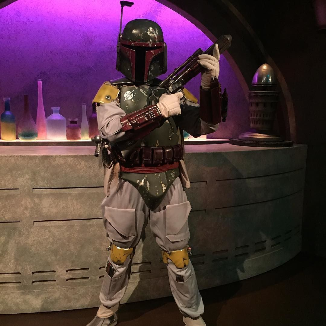 Boba Fett standing in front the Cantina