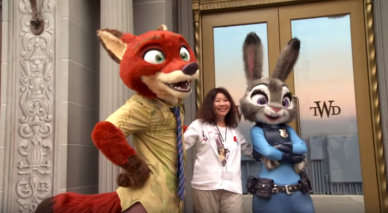 Character meet and greets at Disneyland: Nick and Judy posing with woman