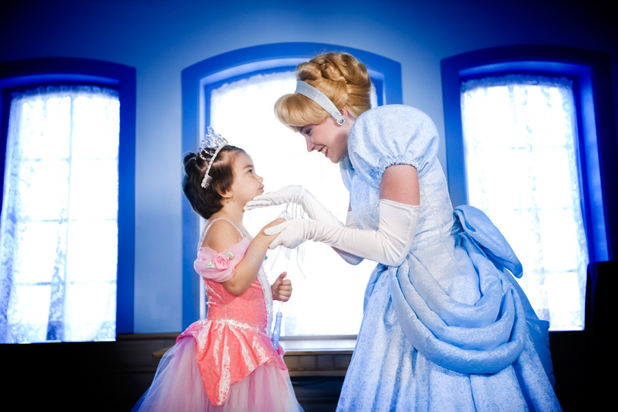 Cinderella holding hands with small girl