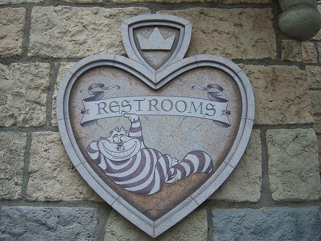 Close up image of restroom bathroom sign in Fantasyland