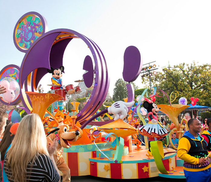 Side view of Mickey Mouse parades float: Disneyland Parades Guide