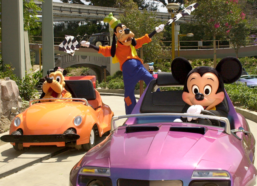 Disney characters riding Autotopia cars