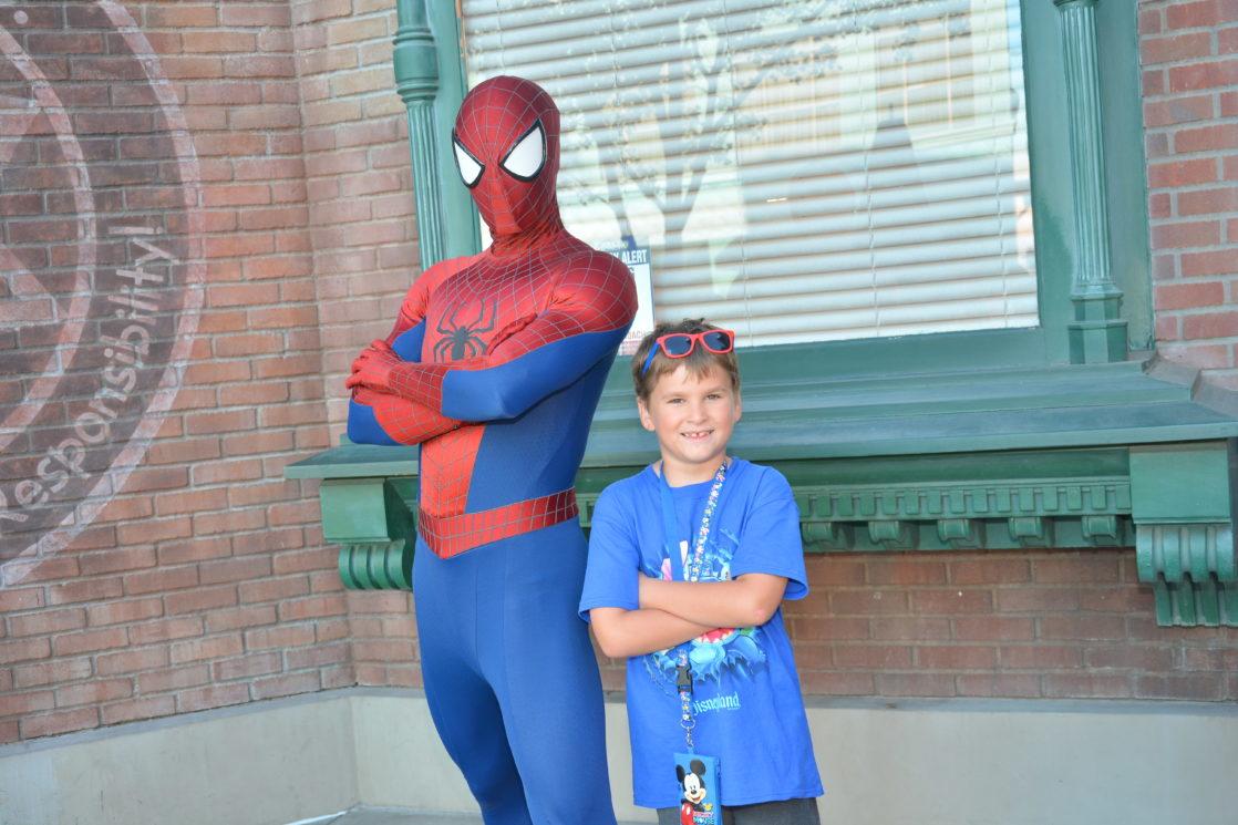 Boy posing with spiderman