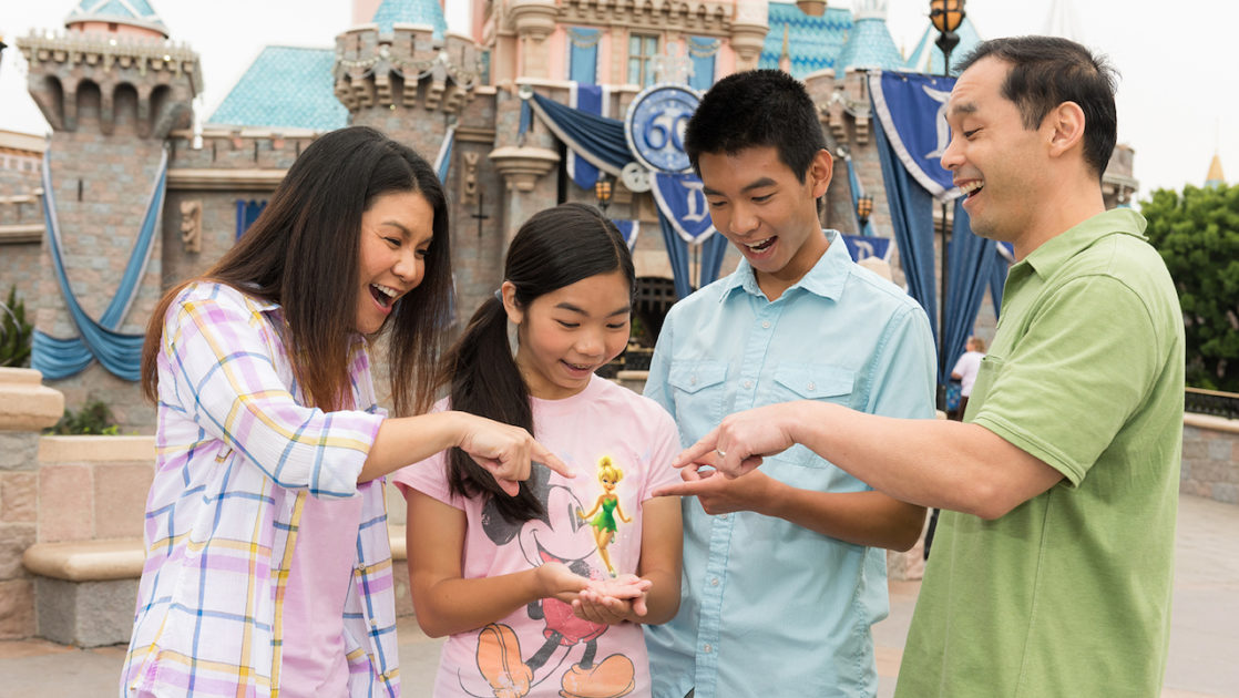 Family holding tinkerbell in their hands