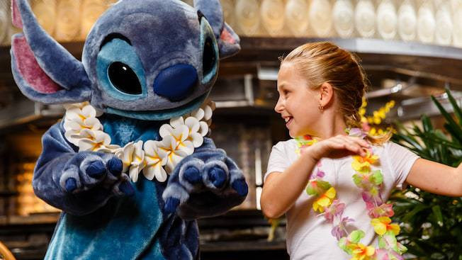 Stitch and little girl dancing together