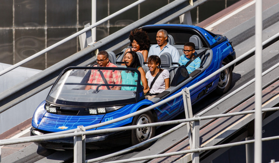 Family on Walt Disney World ride smiling and laughing