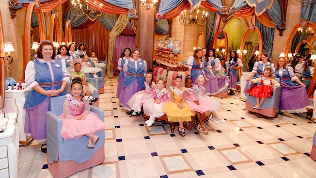 Inside of the boutique with smiling girls dressed as Princesses