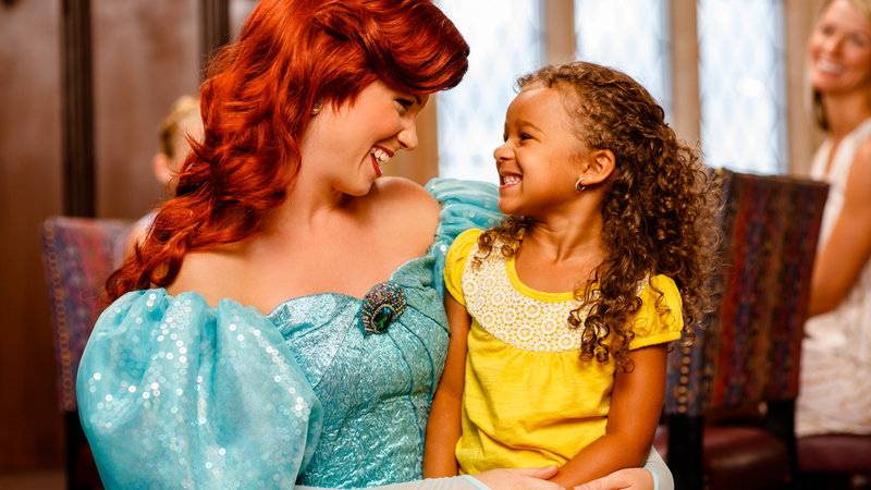 Little girl sitting on Ariel's lap
