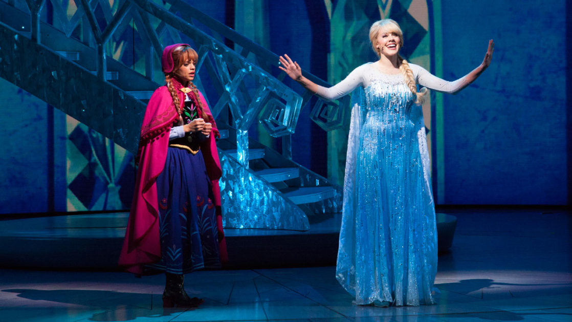 Anna and Elsa on stage during Frozen Live