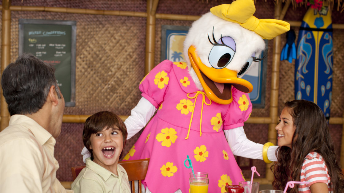 Daisy Duck smiling at children