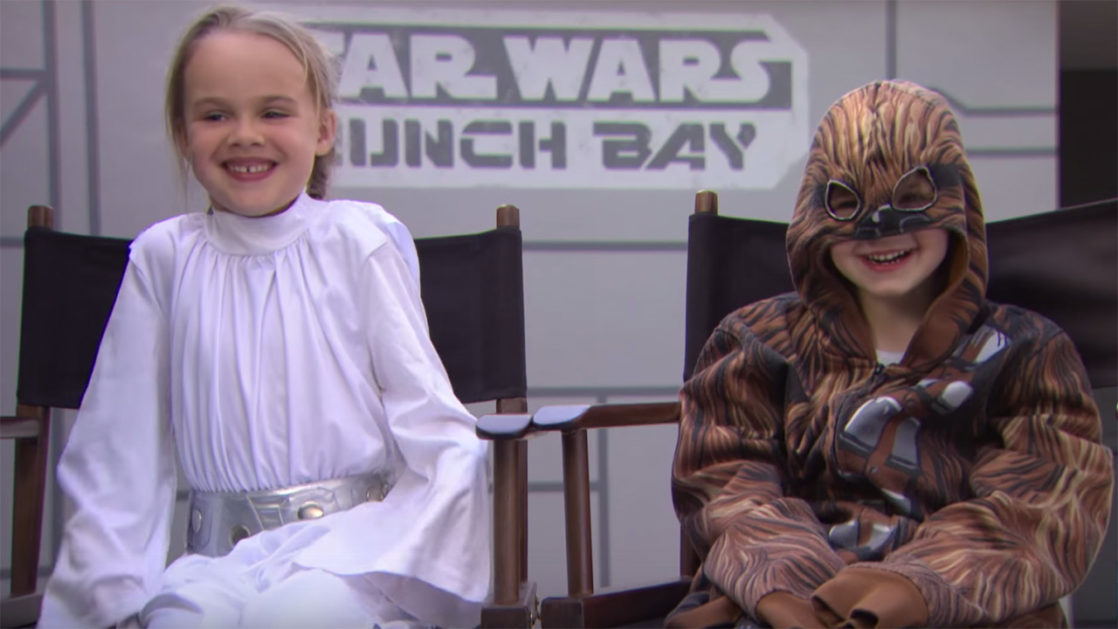 Little girl and boy dressed up as Star Wars characters in the Launch Bay
