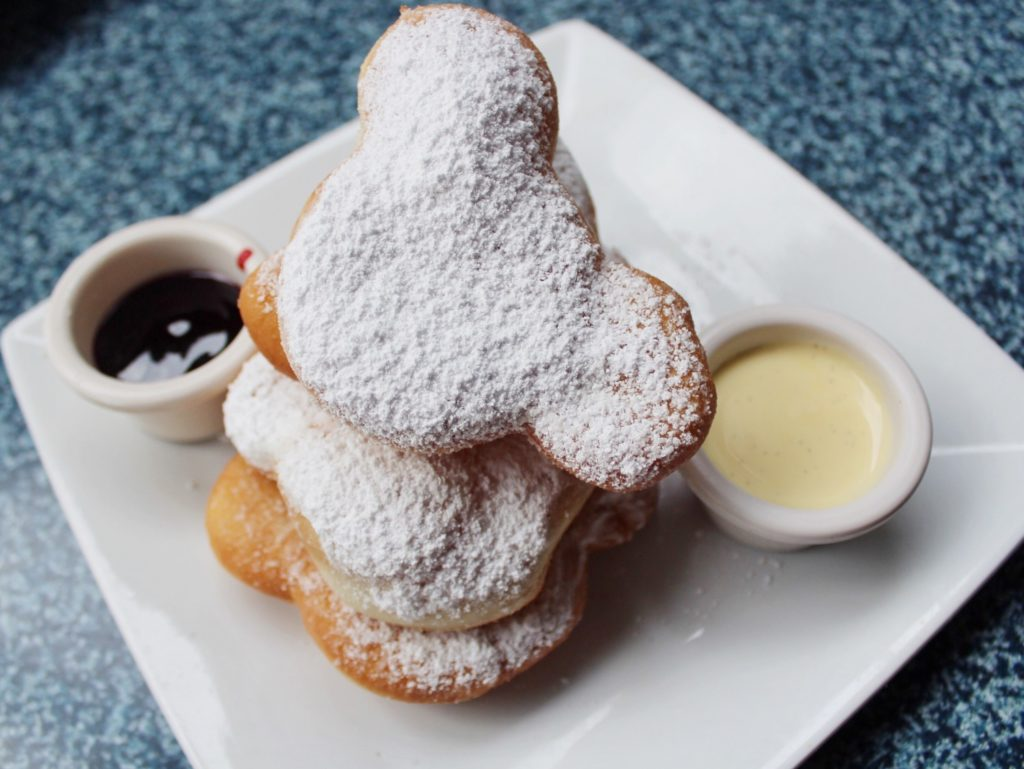 Mickey shaped pastries with dipping sauce