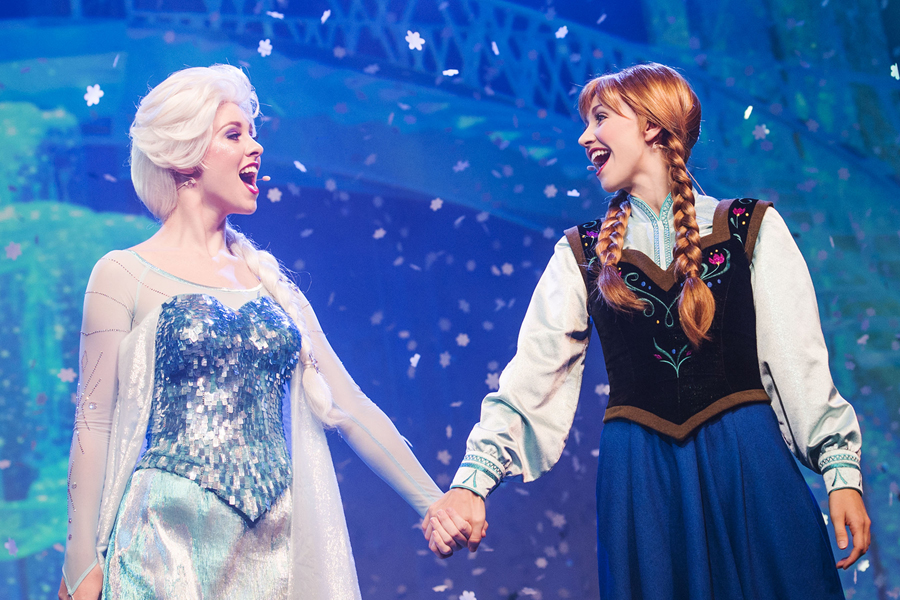 Anna and Elsa holds hang while singing