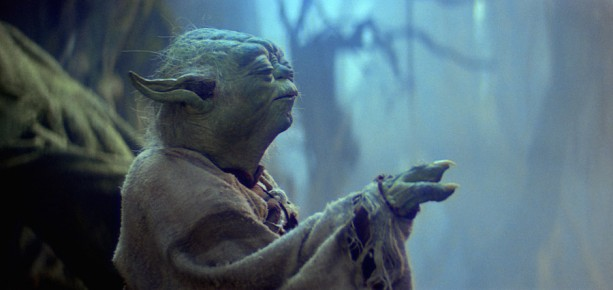 Yoda with his eyes closed and hand out