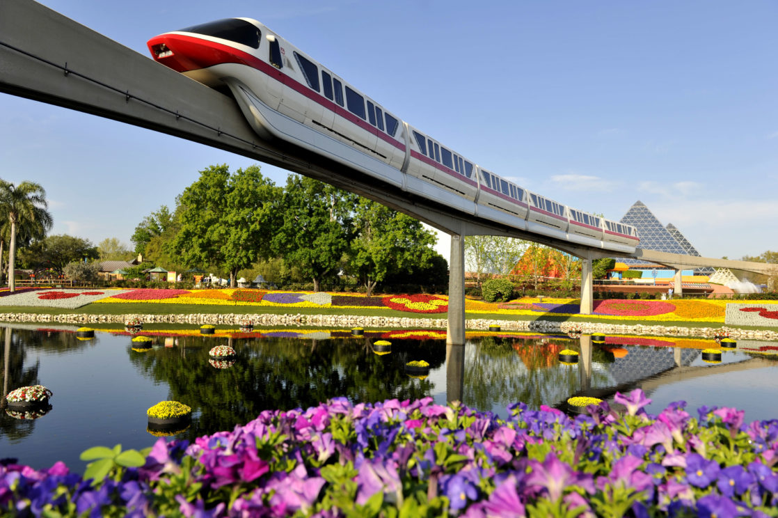 Monorail outside of Epcot going over the flowers