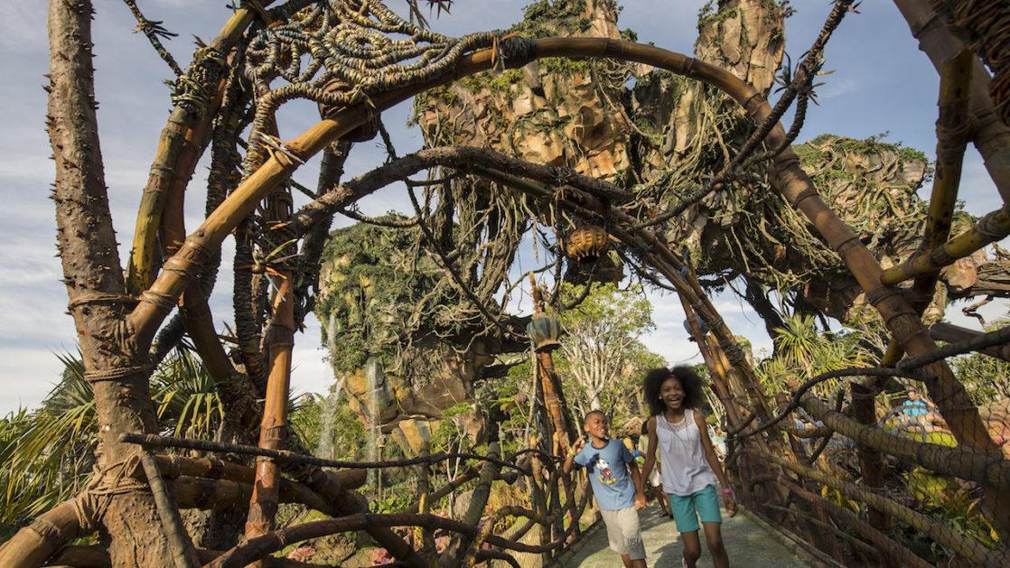 Two children walk over a bridge in Pandora