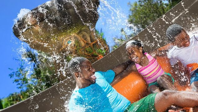 Family rides a water ride in Typhoon Lagoon