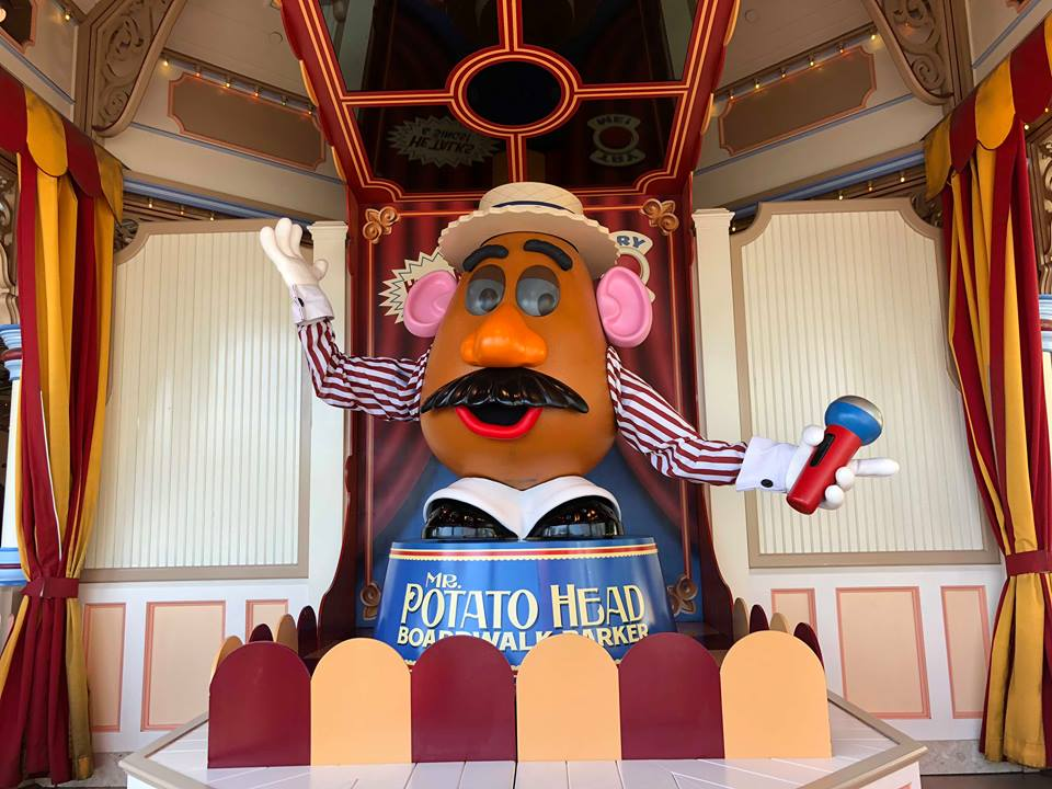 Mr Potato Head in front of Toy Story Midway Mania