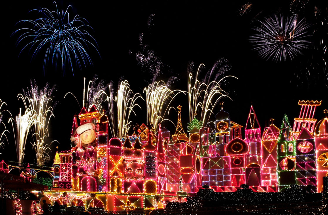 Holiday magic fireworks in fron its a small world