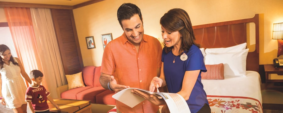 Husband and wife looking at hotel guide and smiling