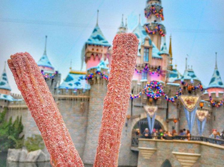 Peppermint churro in front of Sleeping Beauty castle