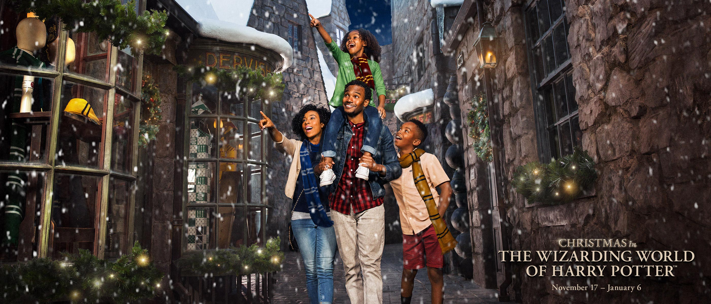 Family of four walks through the Wizarding World of Harry Potter during snowfall