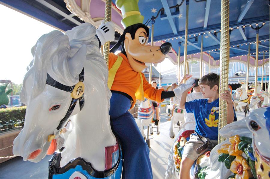 Goofy high fiving little boy on a horse