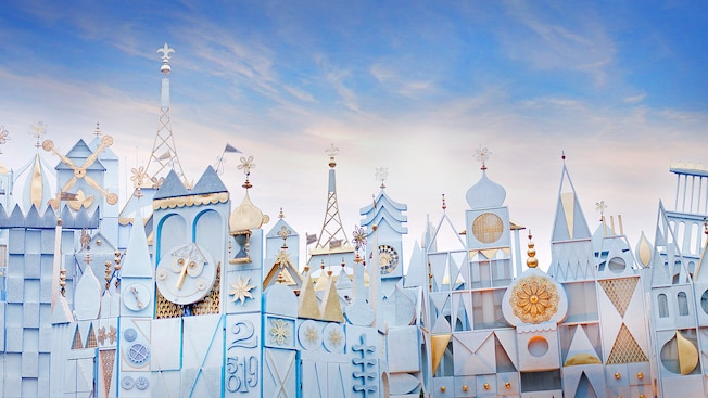 it's a small world facade with bright blue background