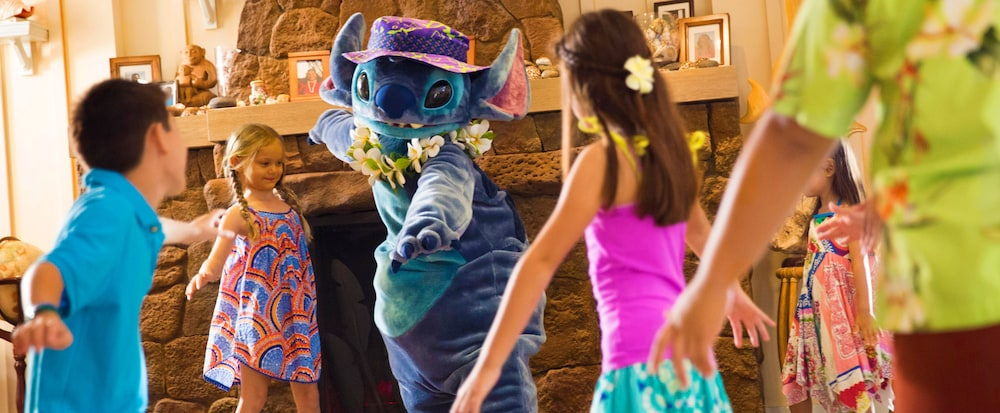 Stitch doing a dance with small children at the resort