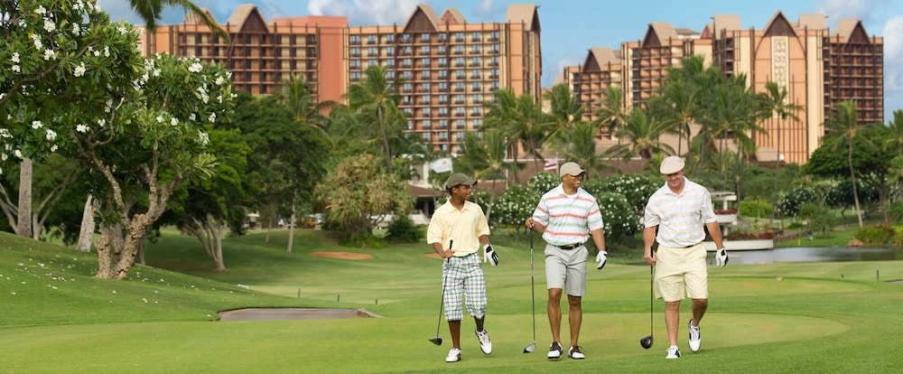 Three men playing golf at the Disney Aulani Resort
