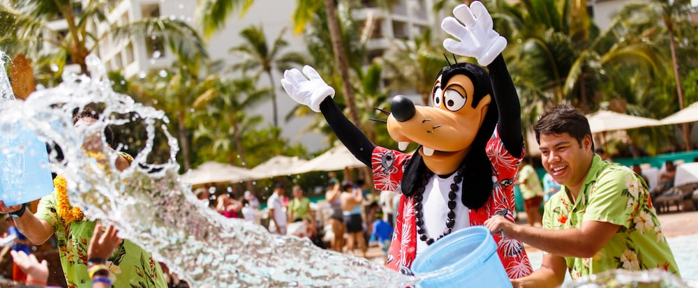 Goofy and cast members splashing in the water