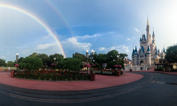 Magic Kingdom with a rainbow next to Cinderella's Castle