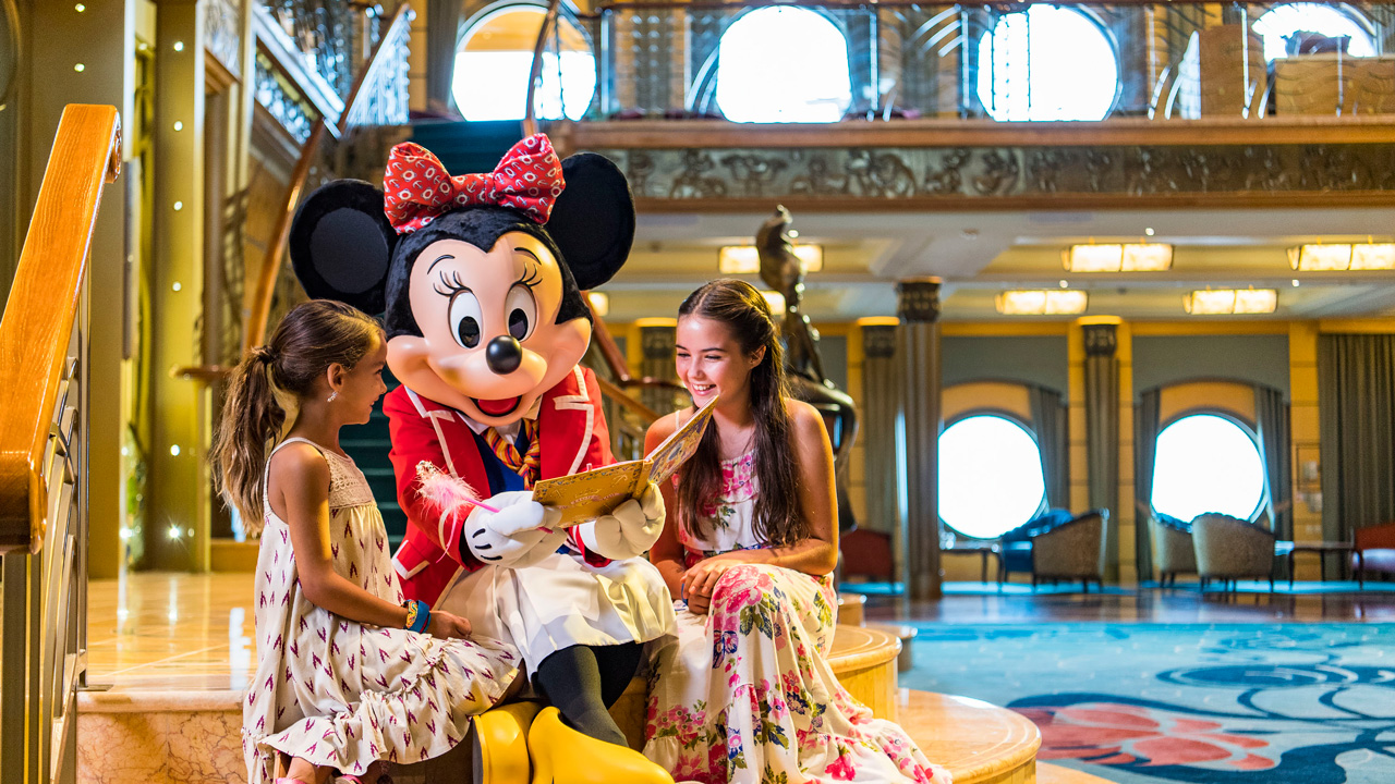 Minnie reading a book to two girls on Cruise Ship